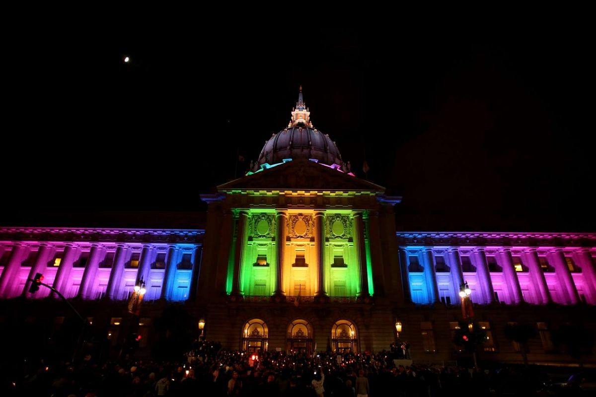People attend a candlelight vigil in San Francisco for the victims of the Orlando shooting on June 12, 2016.