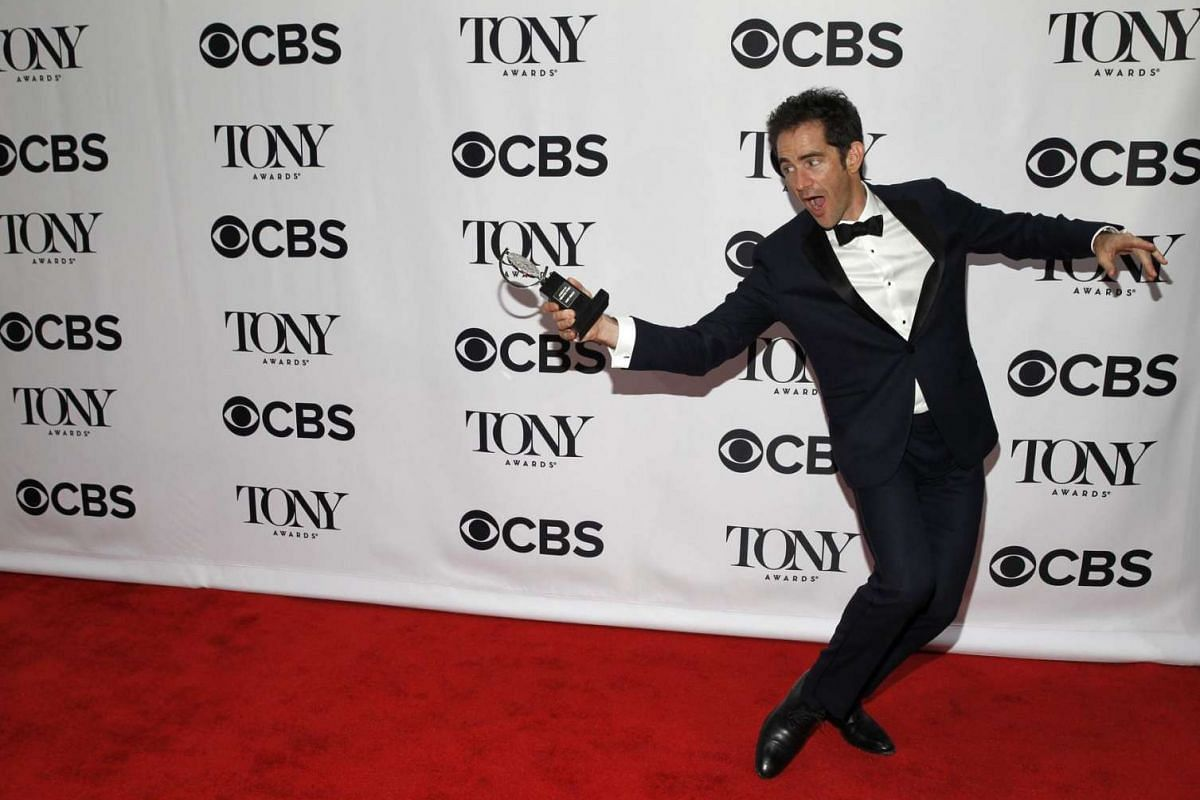 Choreographer Andy Blankenbuehler poses backstage with his award for Best Choreography for Hamilton.