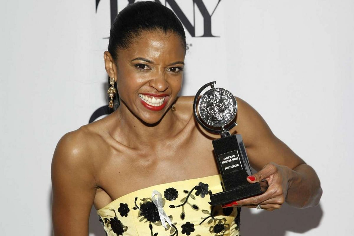 Actress Renee Elise Goldsberry poses with the award for best performance by a featured actress in a musical for Hamilton.