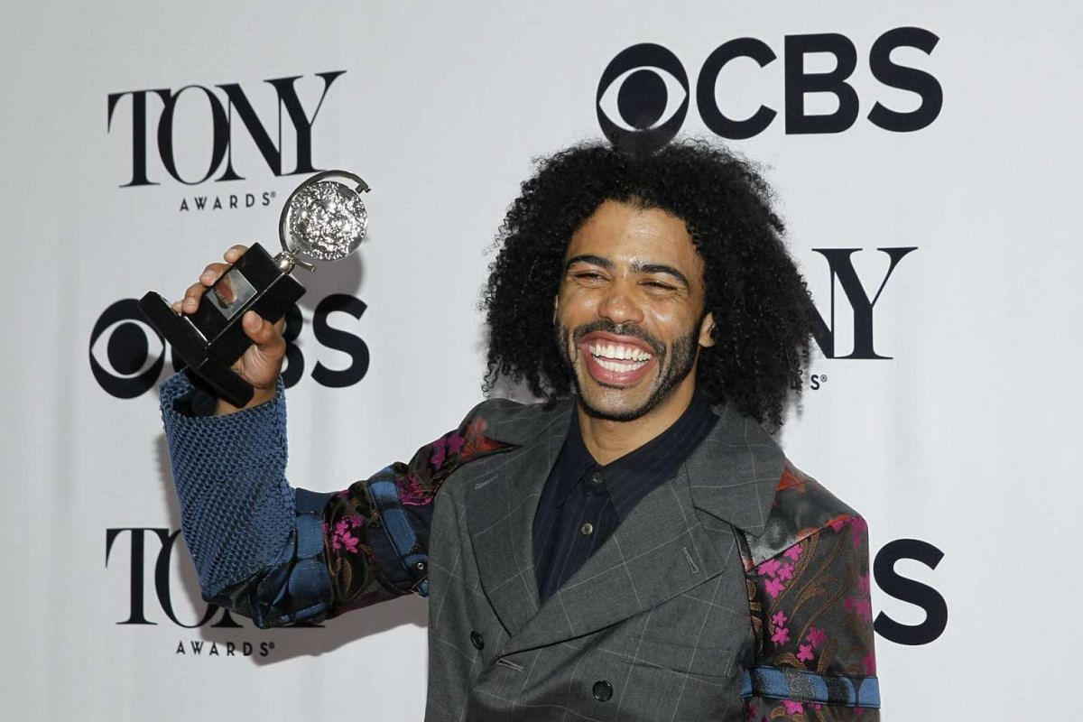 Actor Daveed Diggs poses with his award for best performance by an actor in a featured role in a musical for Hamilton.