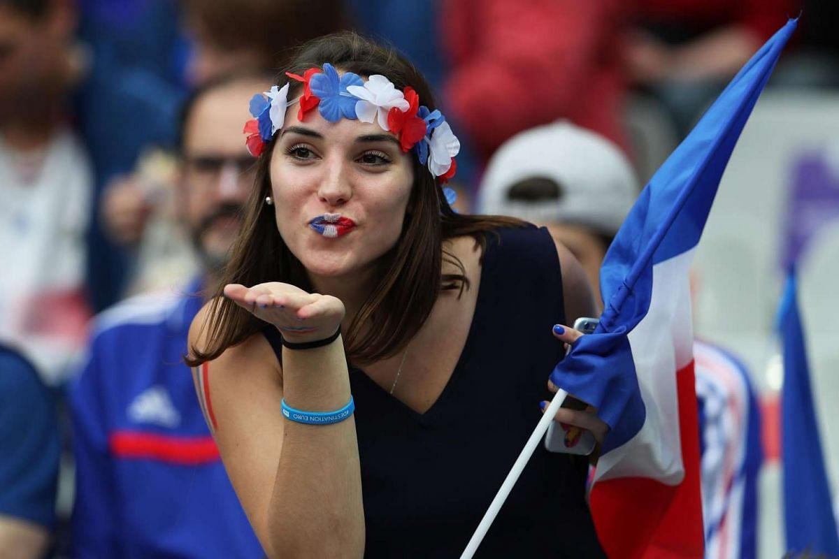 A French fan blows a kiss before the match between France and Romania at Stade de France on June 10, 2016.