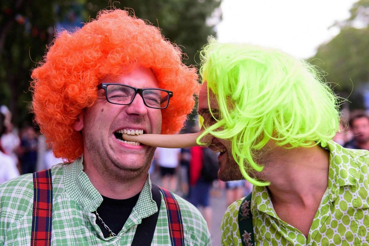 Costumed fans pose for photographs as they arrive at the Stade Velodrome in Marseille on June 11, 2016, ahead of England's match against Russia at the Euro 2016 football tournament.
