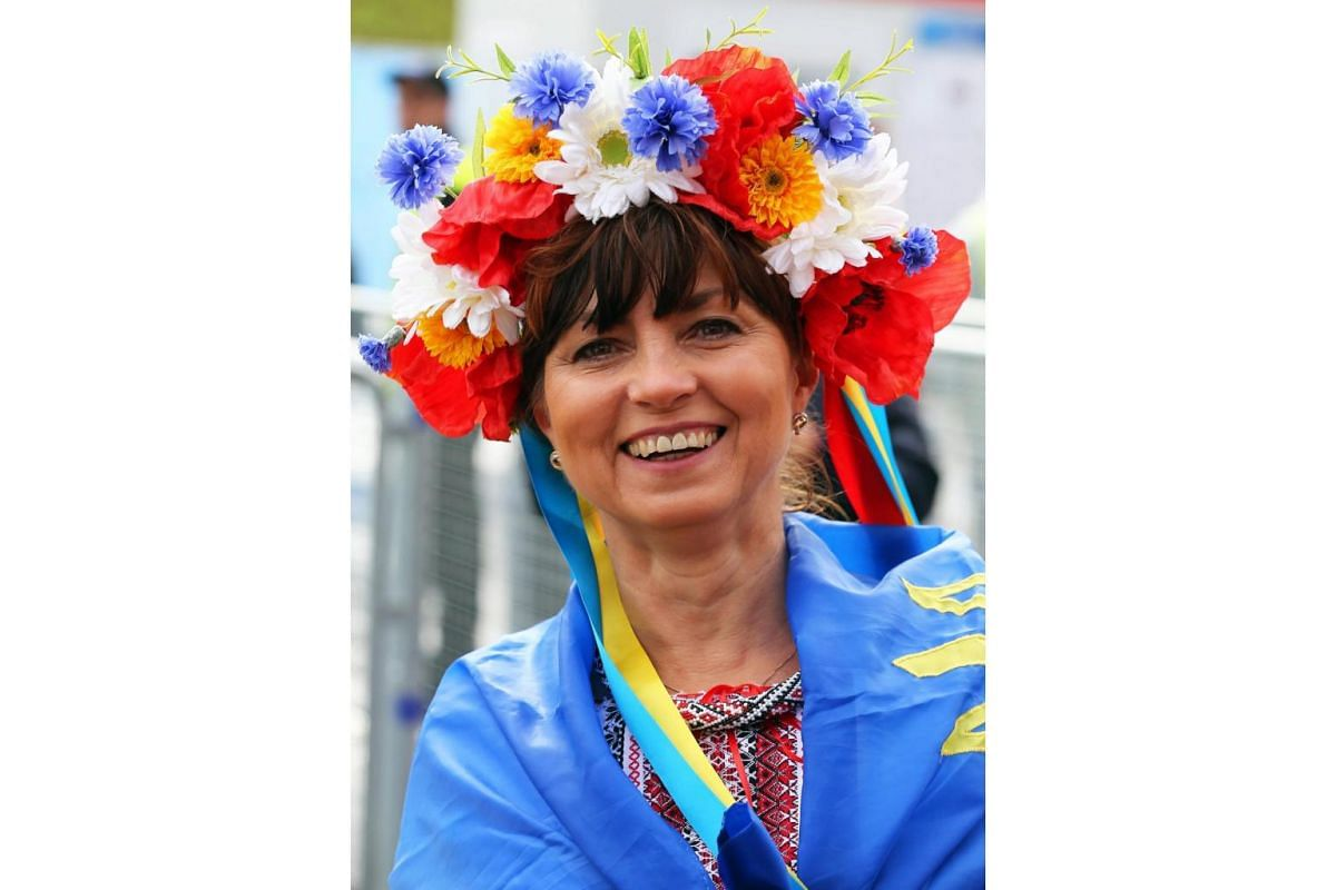 An Ukrainian fan smiles before the UEFA Euro 2016 group C preliminary round match between Germany and Ukraine at Stade Pierre Mauroy in Lille Metropole, France on June 12, 2016.