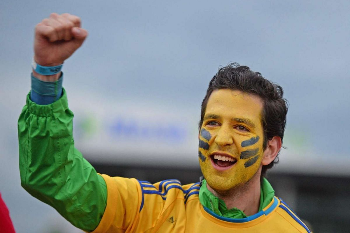 An Ukrainian fan on the fair ground in Freiburg, Germany on June 12, 2016, during the public viewing of the Uefa Euro 2016 match between Germany and Ukraine in Lille.