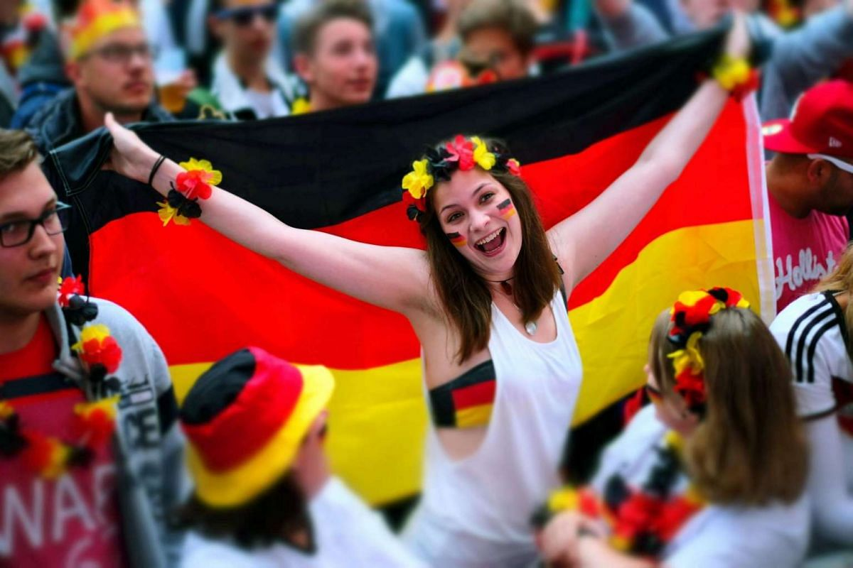 Fans at the public viewing in Hanover wait for the start of the broadcast of the Uefa Euro 2016 soccer match between Ukraine and Germany in Hanover, Germany on June 12, 2016.