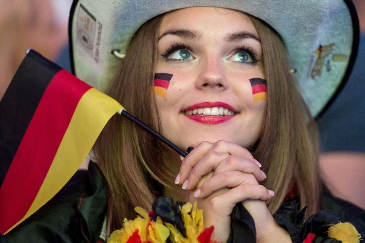 German fans at Commerzbank-Arena in Frankfurt, Germany on June 12, 2016, cheer during the public viewing of the Uefa Euro 2016 match between Germany and Ukraine in Lille.