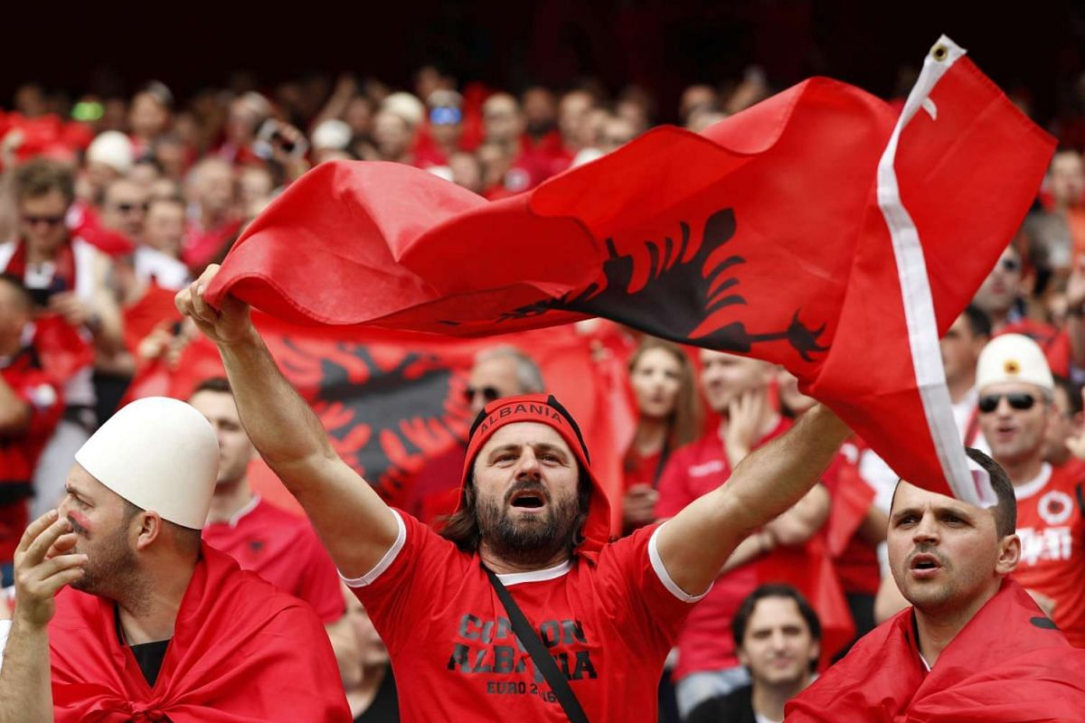 Albania fans cheer before Albania's match against Switzerland at Stade Bollaert-Delelis on June 11, 2016.