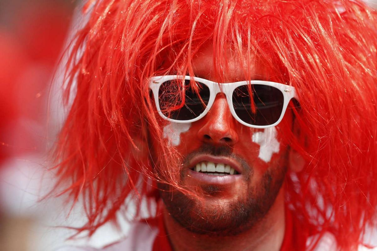 A Switzerland fan wearing face paint before Switzerland's match against Albania at Stade Bollaert-Delelis on June 11, 2016.