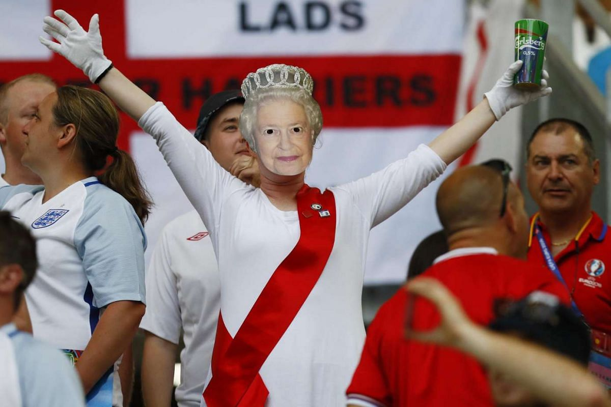 An England fan dressed as Britain's Queen Elizabeth cheers ahead of England's match against Russia at the Euro 2016 football tournament on June 11, 2016.