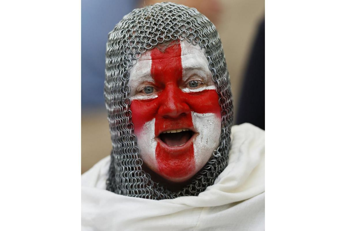 An England fan in fancy dress ahead of England's match against Russia at the Euro 2016 football tournament on June 11, 2016.