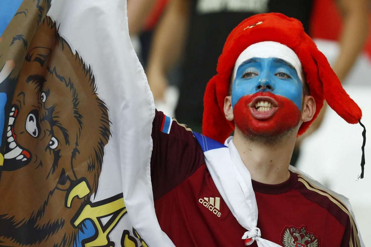 A Russian fan waves a flag ahead of England's match against Russia at the Euro 2016 football tournament on June 11, 2016.