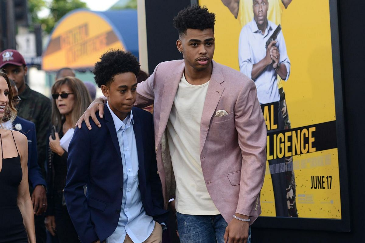 Los Angeles Lakers player D'Angelo Russell (right) attends the premiere with his brother.