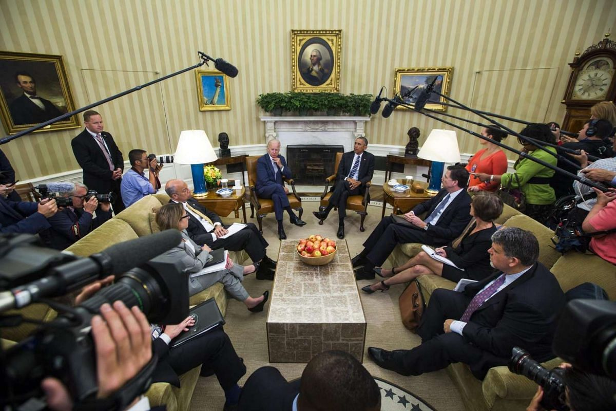 US President Barack Obama speaks to the media about the Orlando shooting in the Oval Office of the White House in Washington, DC, on June 13, 2016. Obama said that so far there is no evidence of a larger plot.