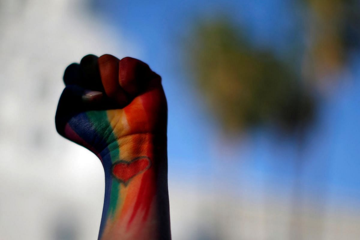 Dominique Hernandez holds up her fist painted in the colours of a rainbow, with a heart on her pulse, as she attends a vigil in memory of victims one day after a mass shooting at the Pulse gay night club in Orlando, in Los Angeles, on June 13, 2016.