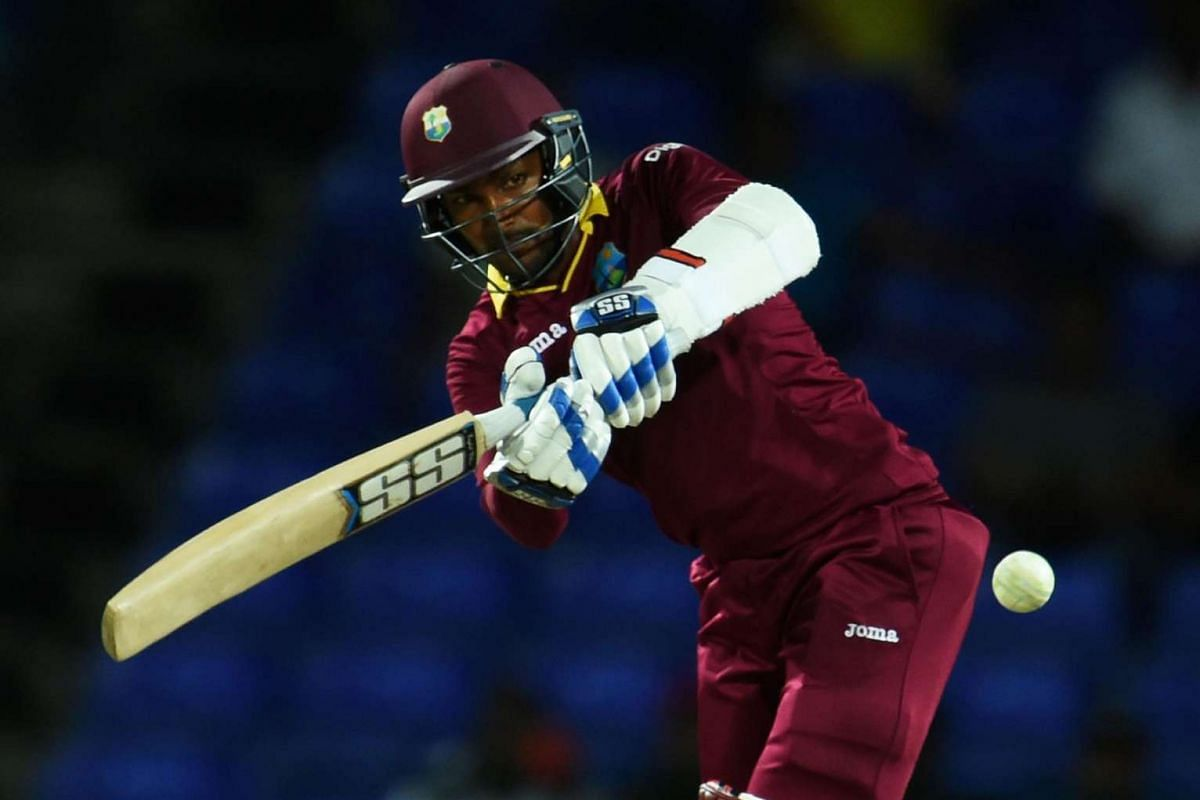 West Indies cricketer Denesh Ramdin plays a shot against Australia during their One Day International match of the Tri-nation Series at the Warner Park stadium in Basseterre, Saint Kitts, on June 13, 2016.