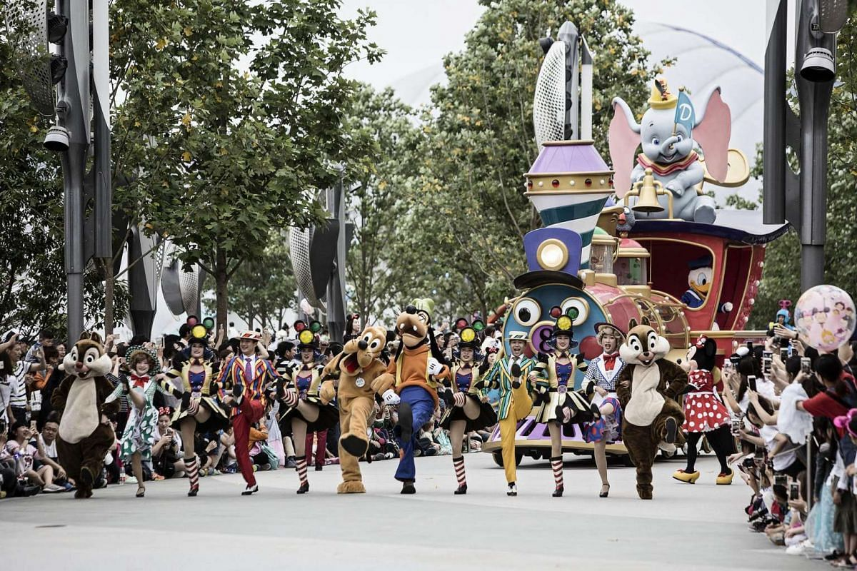 Actors dressed in costumes march in a parade at Walt Disney Co.'s Shanghai Disneyland theme park on June 8, 2016.