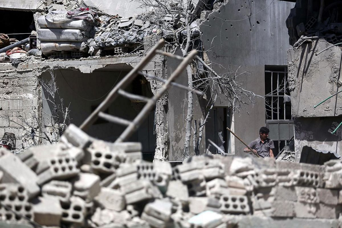 A view of a building that was targeted by airstrikes in Douma, on the outskirts of Damascus, on June 13.