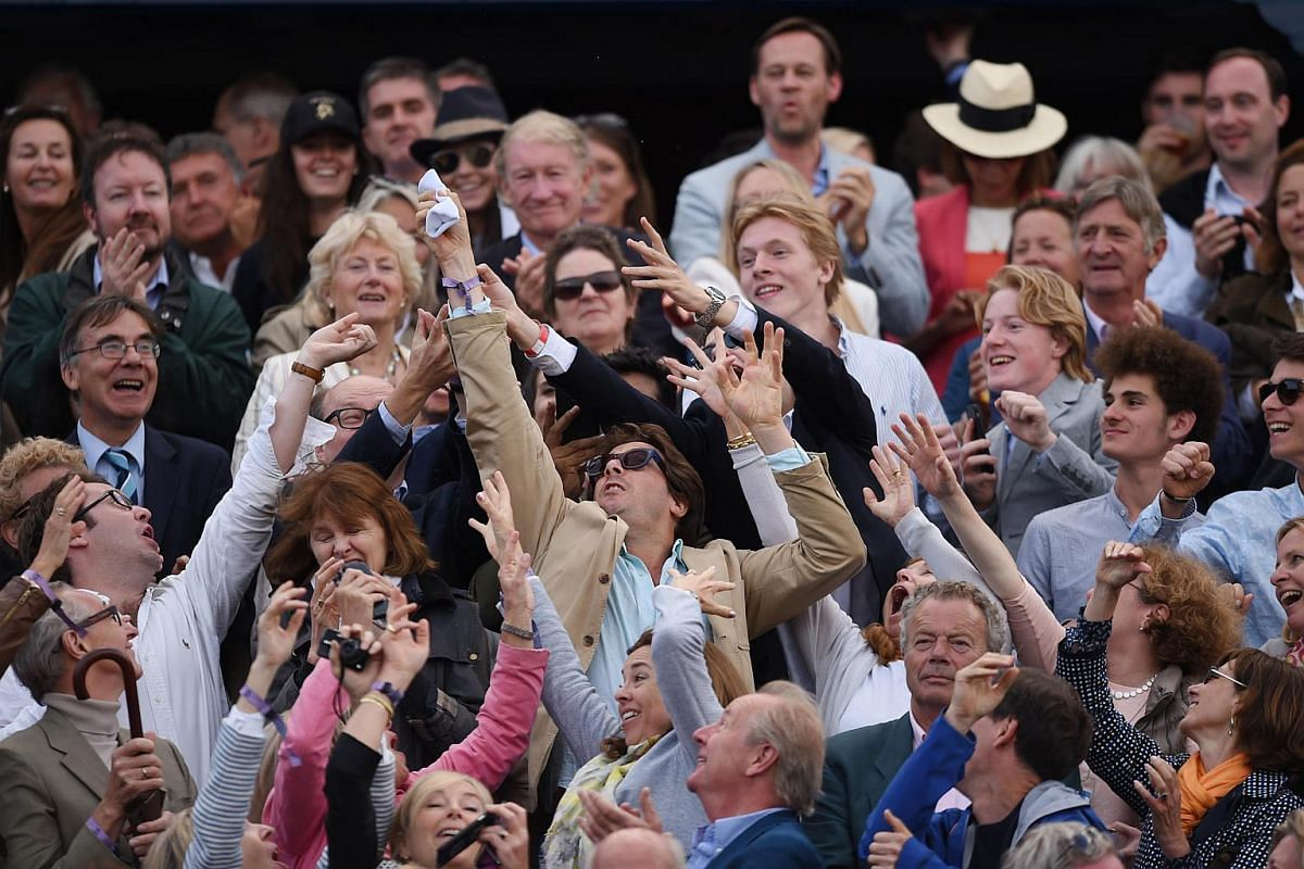 Spectators trying to catch Britain's Andy Murray's wristband, which he threw into the crowd after winning his first round match at the Aegon Championships in London.