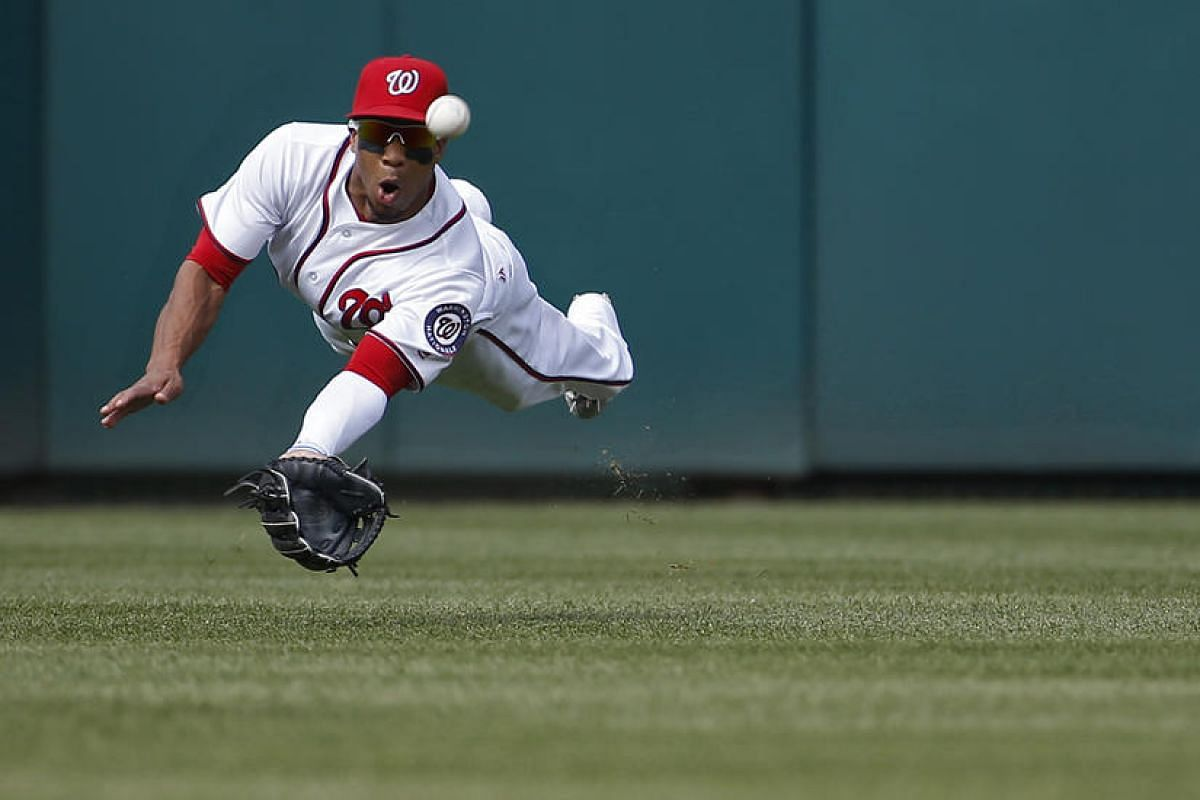 Washington Nationals center fielder Ben Revere dives in an attempt to catch a ball hit by Chicago Cubs right fielder Jason Heyward (not pictured) in the first inning at Nationals Park on June 15, 2016.