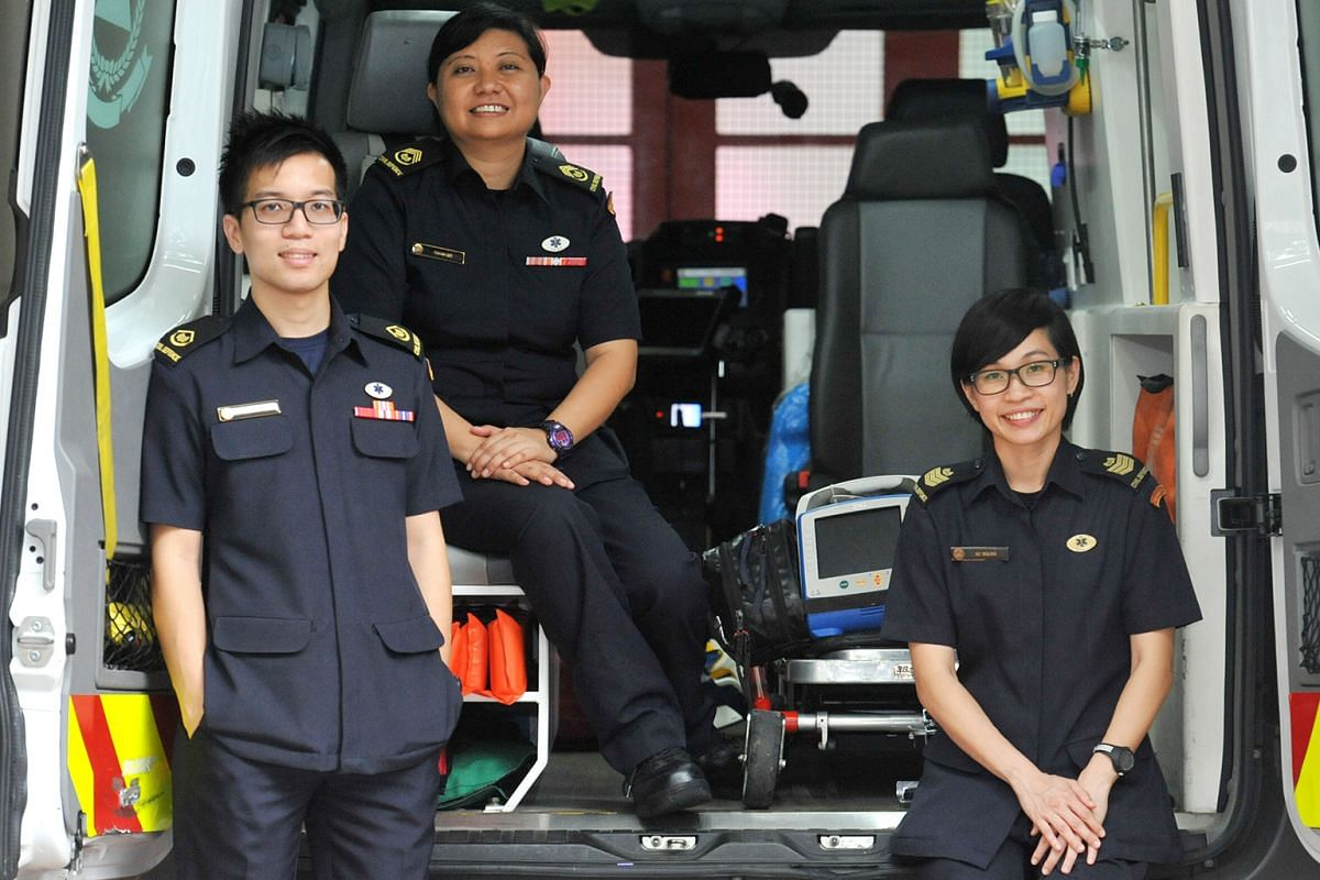 Paramedics (from left) Jonathan Wang, Rahah Mohamed and Xu Xiuling love their job in spite of its challenges.