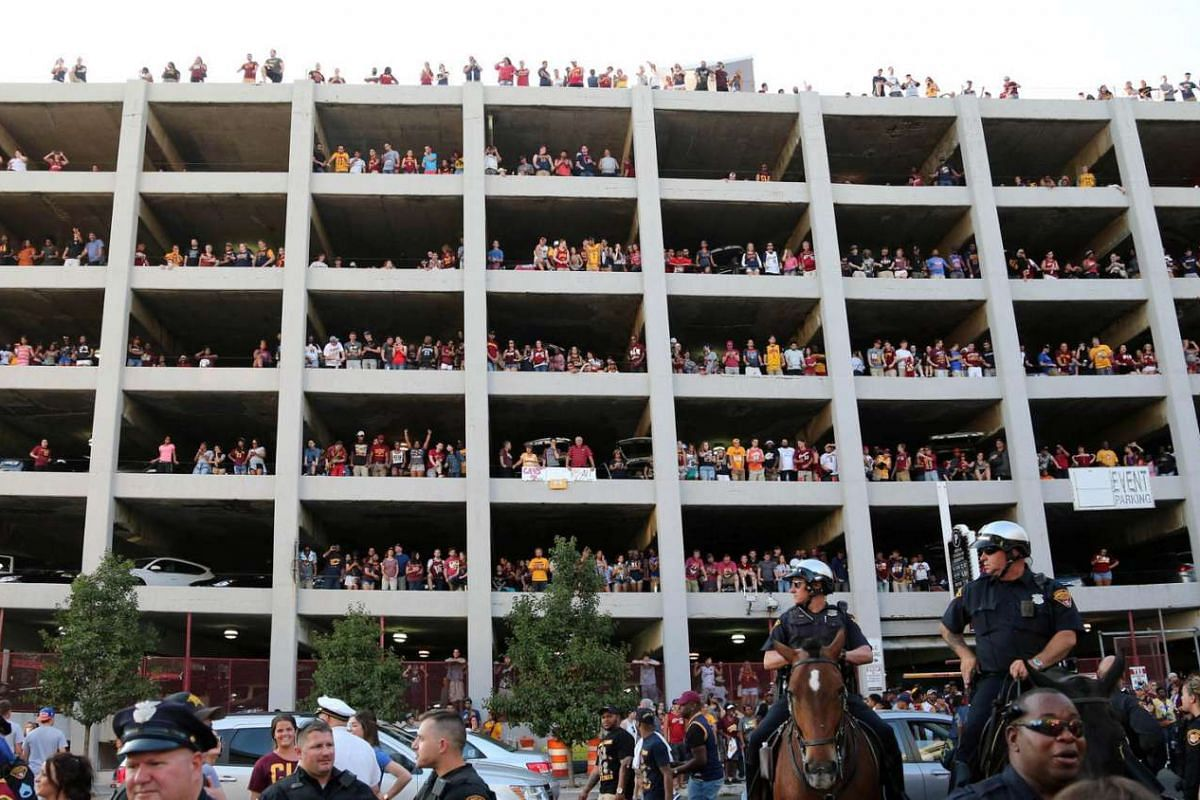 Cleveland Cavaliers fans fill a parking garage to try to get a look at the large TV screens at a watch party at Quicken Loans Arena in Cleveland, Ohio, on June 19, 2016.