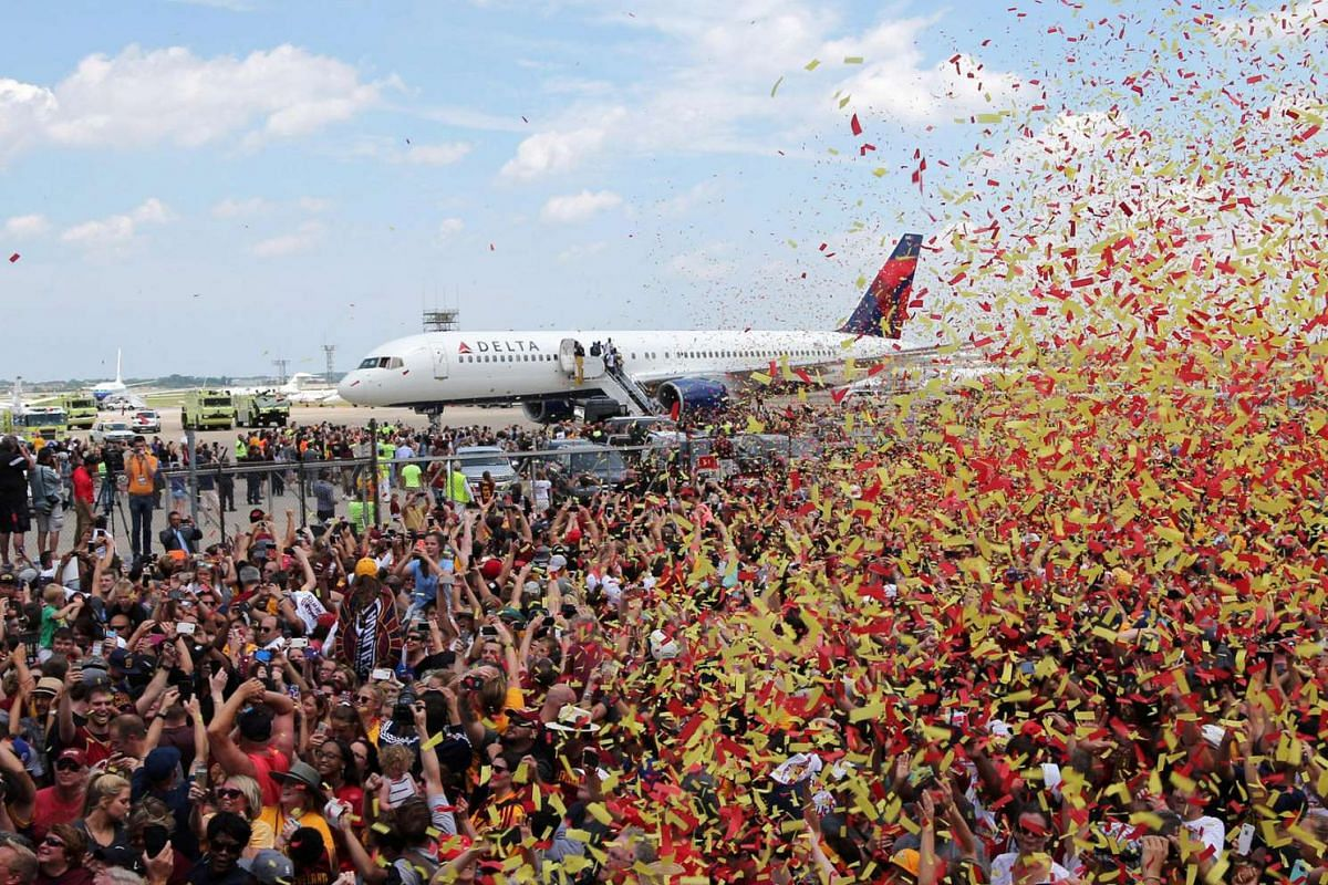 Cleveland Cavaliers fans celebrate as the team arrives home to a welcome party in Cleveland, Ohio, on June 20, 2016.