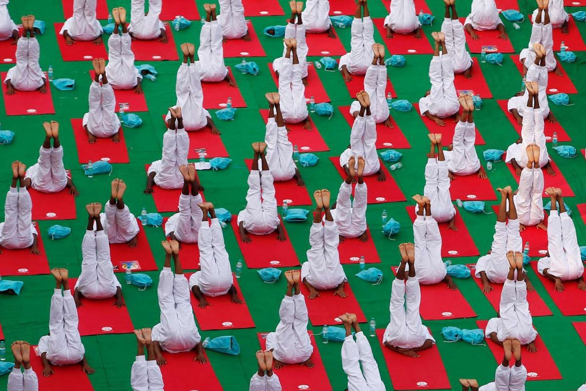 Participants perform yoga during World Yoga Day in New Delhi, India, on June 21, 2016.