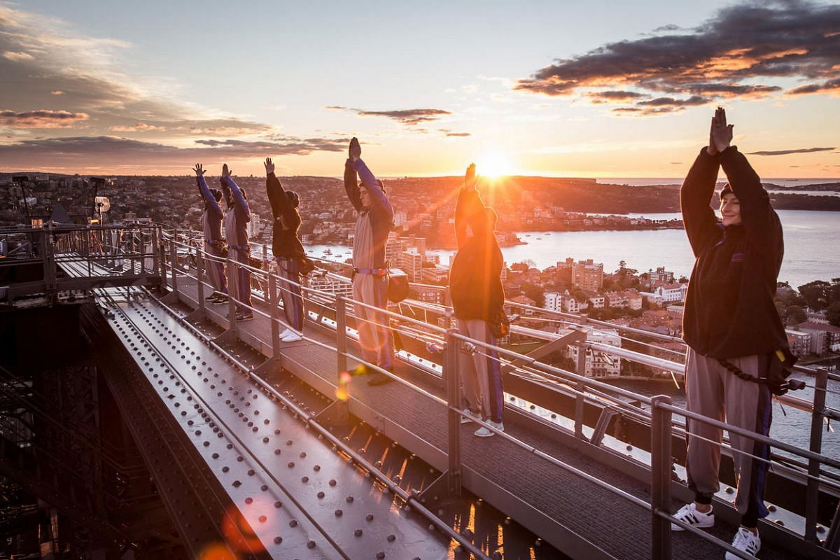 Yoga practitioners mark World Yoga Day for the first time on top of the Sydney Harbour Bridge at sunrise in Sydney, Australia, on June 21.