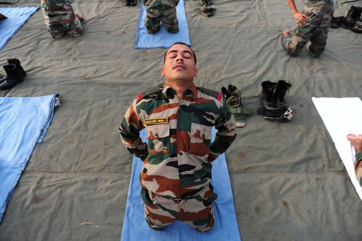 Indian Army soldiers participate in a yoga demonstration on International Yoga Day in Chennai on June 21.