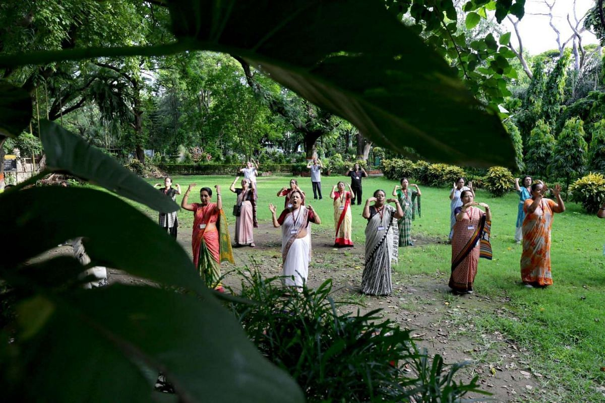 Elderly participants perform yoga exercises during the rehearsals for the second International Day of Yoga in Calcutta, India, on June 21.