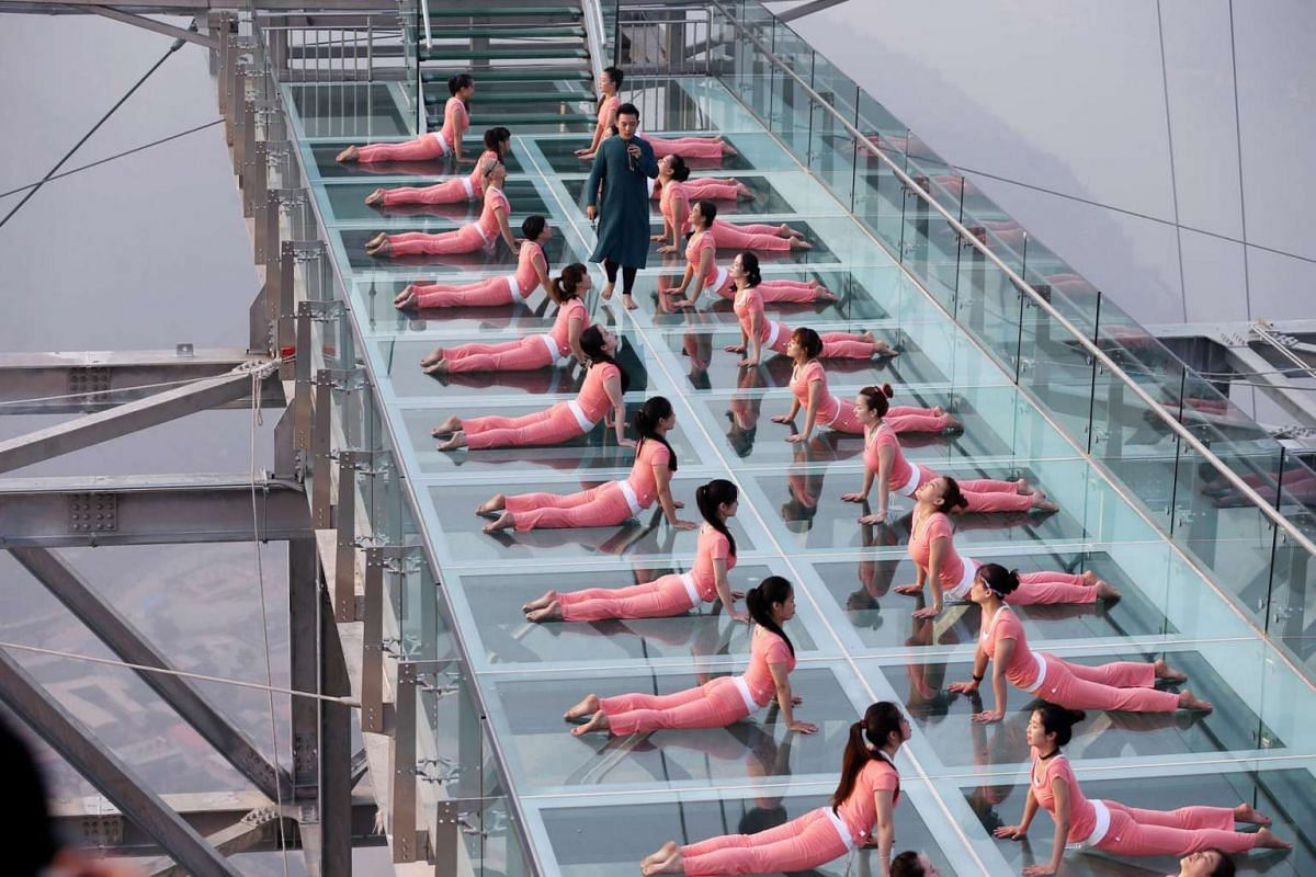 People practice yoga at a tourist spot ahead of the International Day of Yoga, on the outskirts of Beijing, China, on June 20.