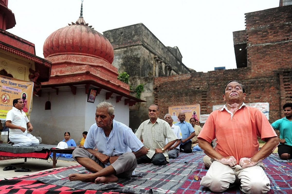 Yoga practitioners take part in a workshop at a temple on the banks of the River Ganges in Allahabad on June 20, ahead of International Yoga Day.