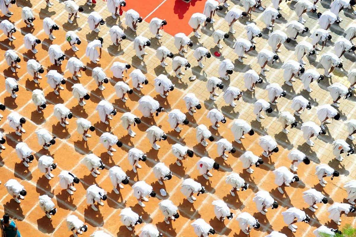 Students participate in a yoga session at a school in Chennai on June 20, a day before International Yoga Day.