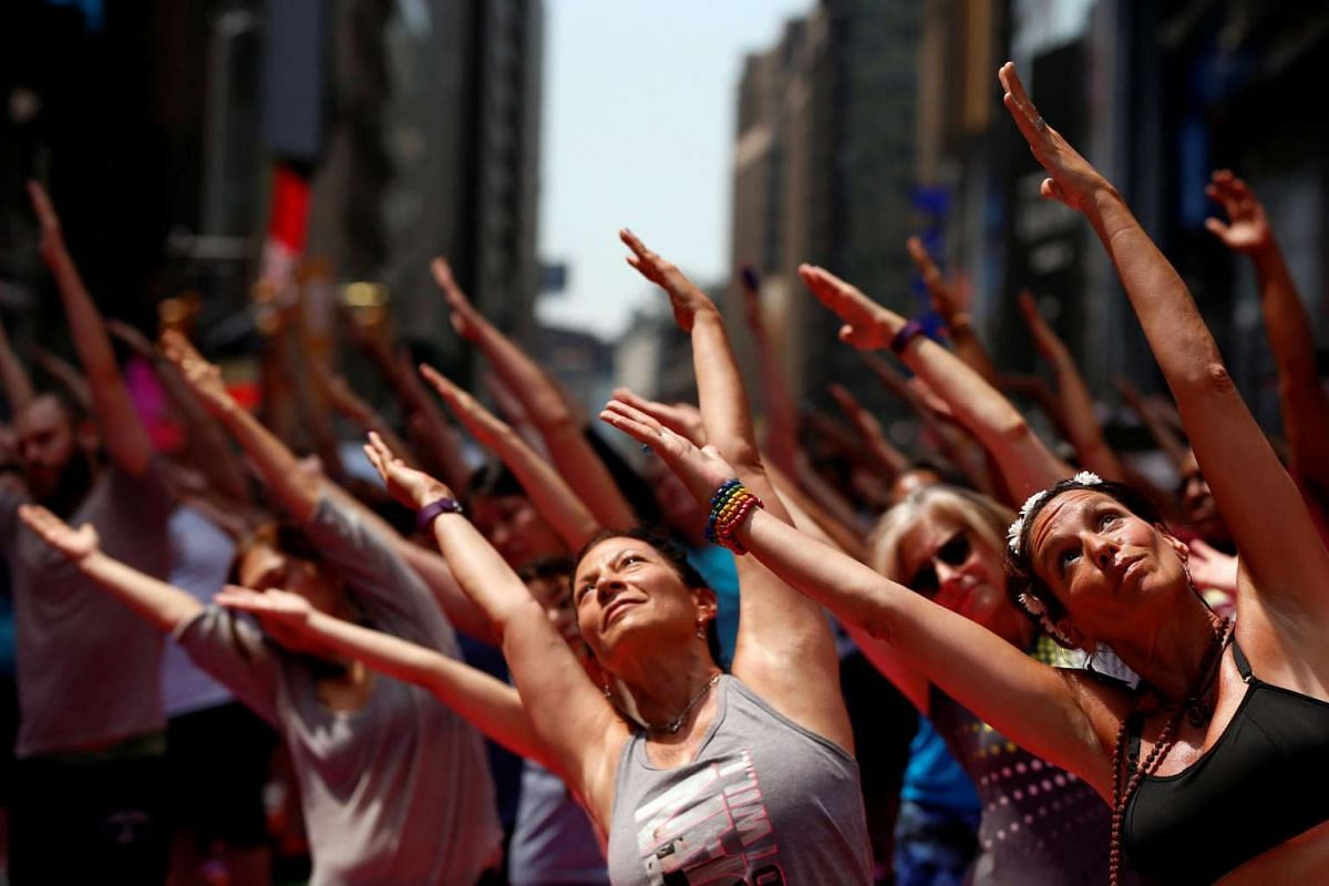 People participate in a yoga class during the 14th annual Solstice in Times Square: Mind Over Madness Yoga event in New York, US, on June 20.