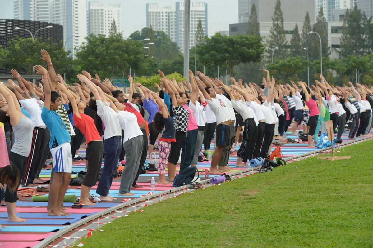 Some 750 people lined up on the track at Home of Athletics in Kallang in Singapore for a free outdoor yoga session on June 19.