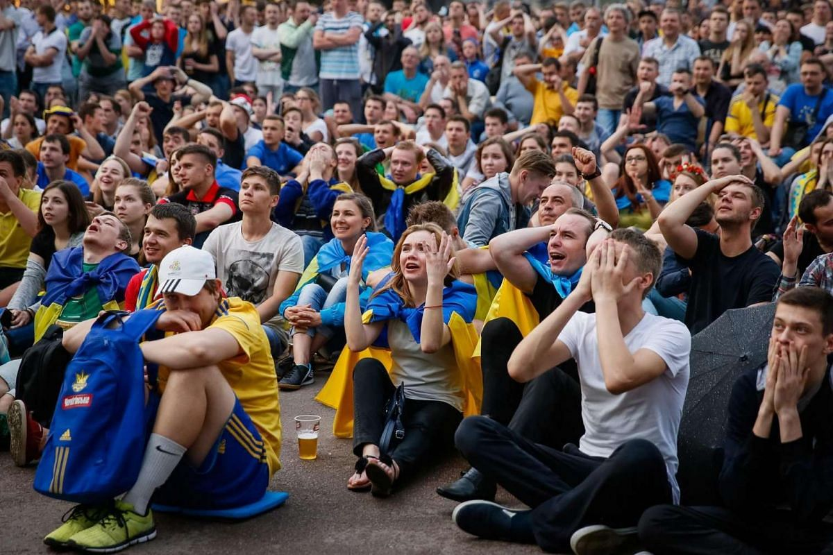 Ukrainian fans watch thematch between Ukraine and Northern Ireland on June 16, 2016.
