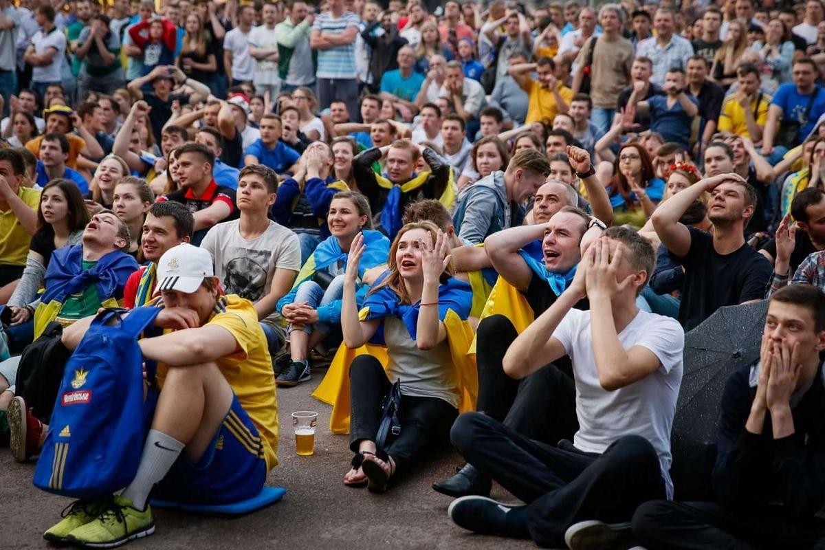 Ukrainian fans watch thematch between Ukraine and Northern Ireland on June 16, 2016.