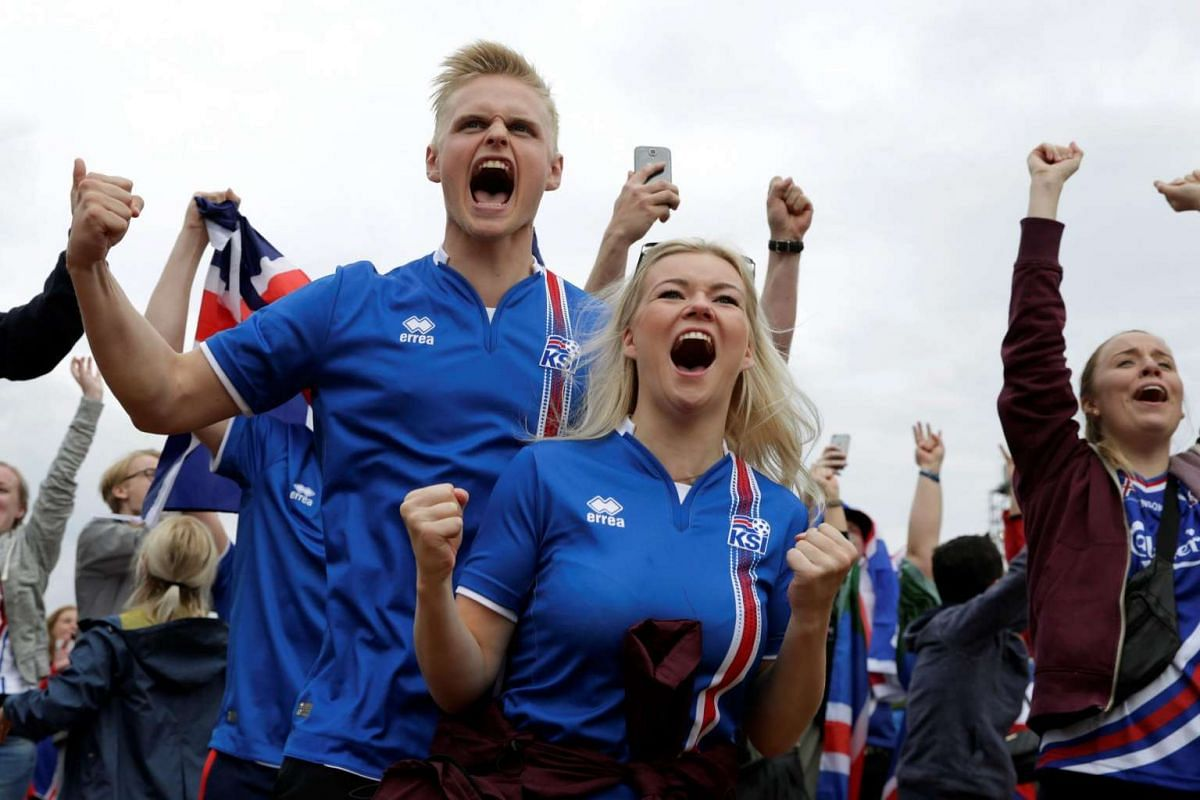 Iceland's supporters react as they watch the match between Iceland and Hungary on June 18, 2016.