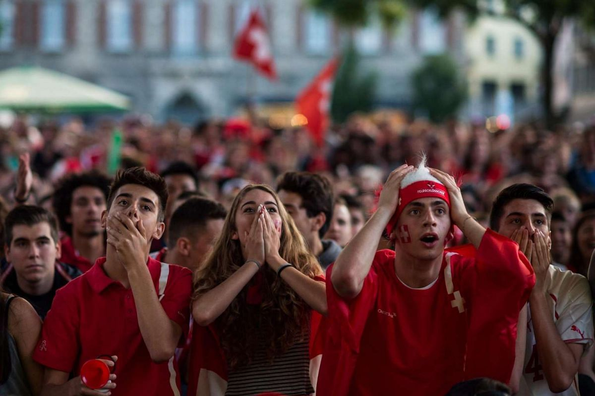 Swiss fans react during the match between France and Switzerland at a public viewing on June 19, 2016.