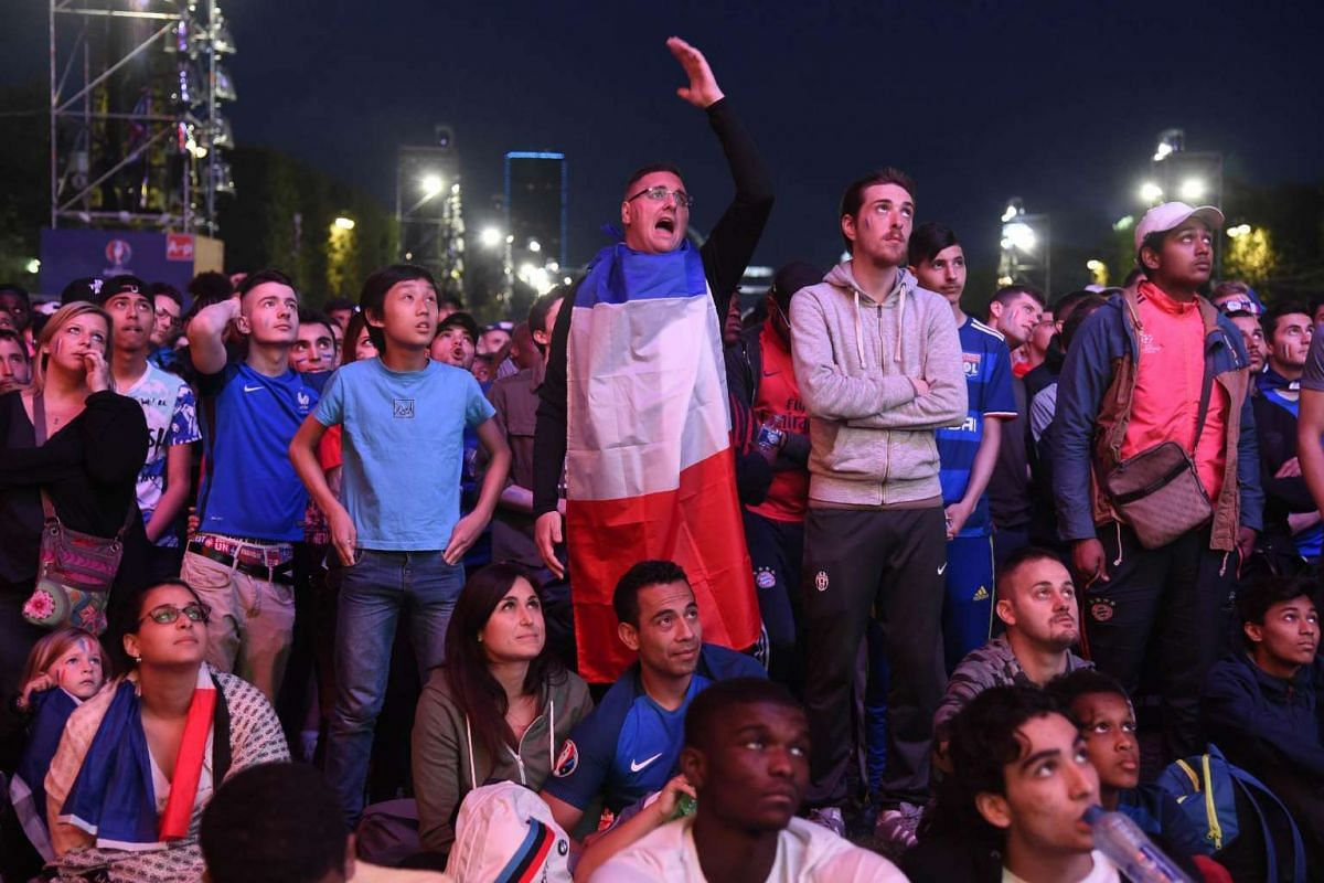 France's supporters watch the match between France and Switzerland on June 19, 2017.