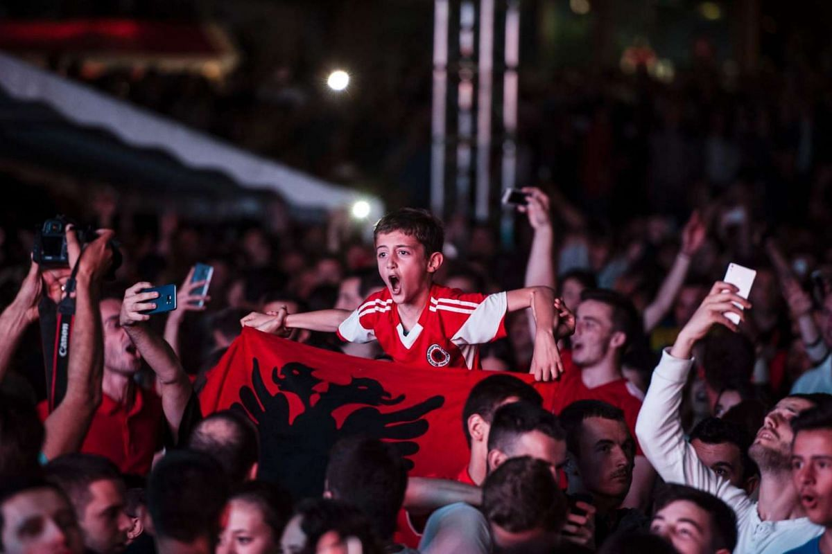 Albania's supporters celebrate during the match between Romania and Albania on June 19, 2016.