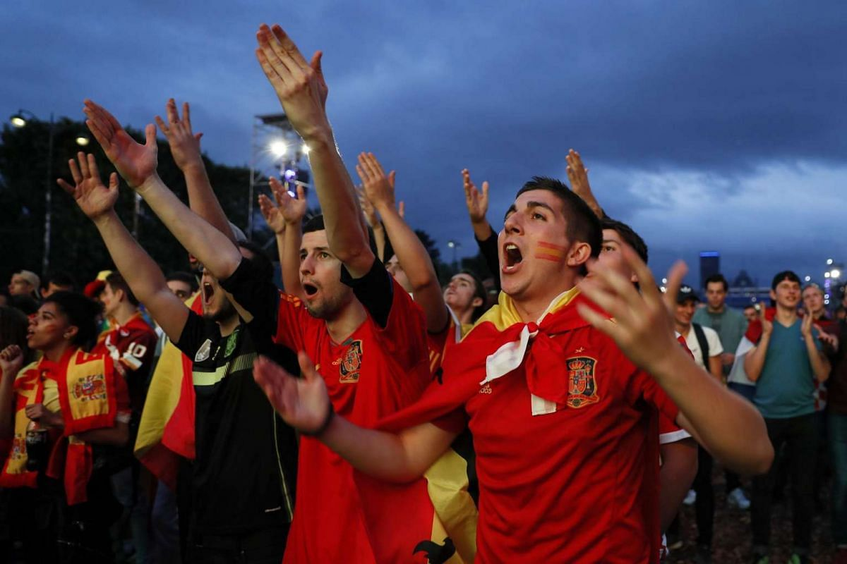 Spain fans react as they watch the match between Croatia and Spain on June 21, 2016.