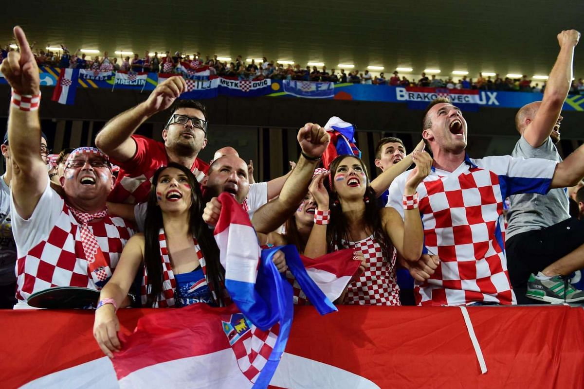Croatia fans celebrate after their team's 2-1 victory during match between Croatia and Spain on June 21, 2016.