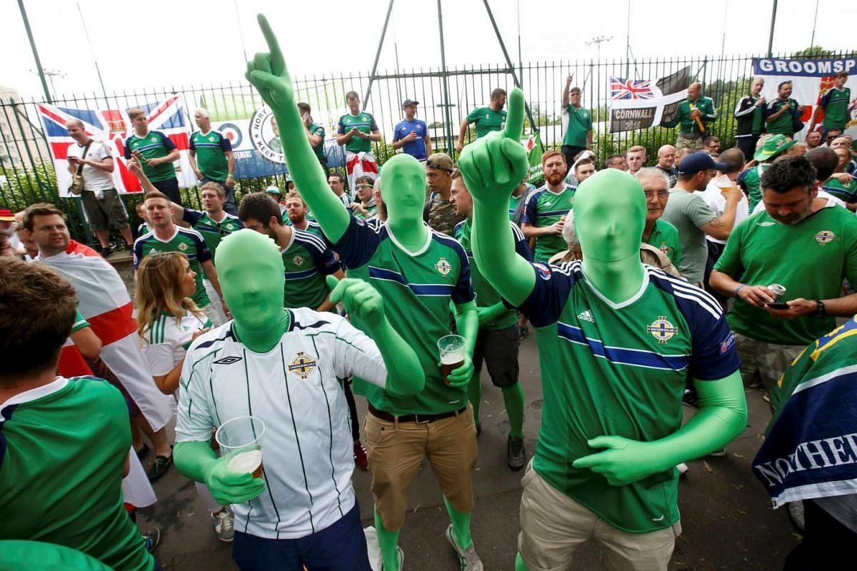 "Northern Ireland supporters attend a ""fan walk"" to go to the Parc des Princes stadium on June 21, 2016."