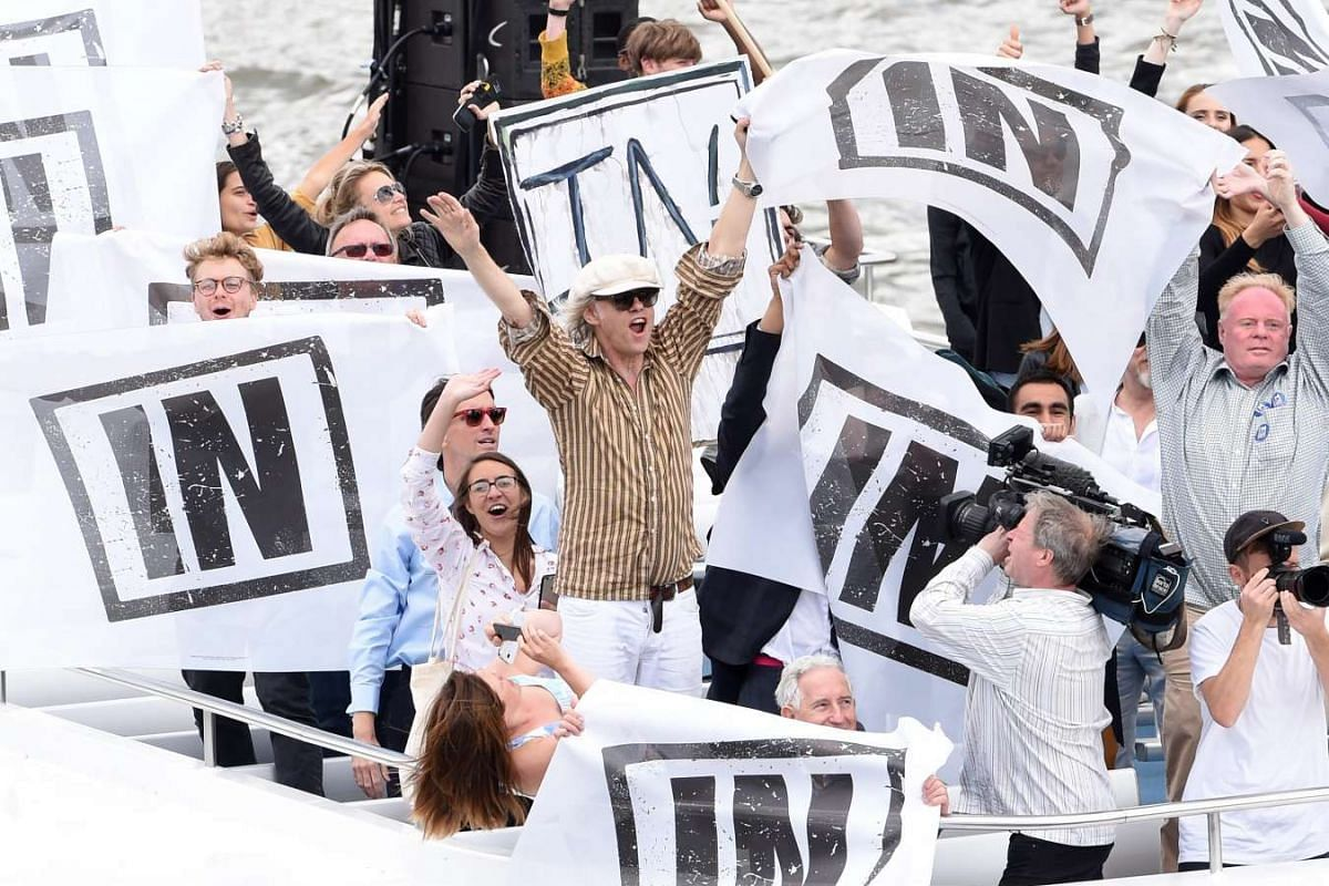 """Rock musician Bob Geldof sails with """"Remain"""" supporters in a counter protest next to a flotilla of fishing trawlers, orgainsed by UKIP leader Nigel Farage, up the river Thames in London, on June 15, 2016."""