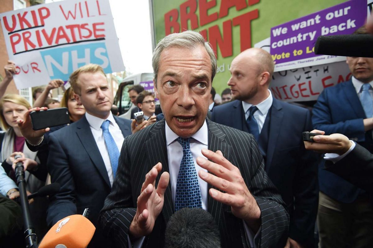 British UKIP leader Nigel Farage speaks to reporters during the launch of a new poster campaign ahead of the EU referendum in Smith Square in London, on June 16, 2016.