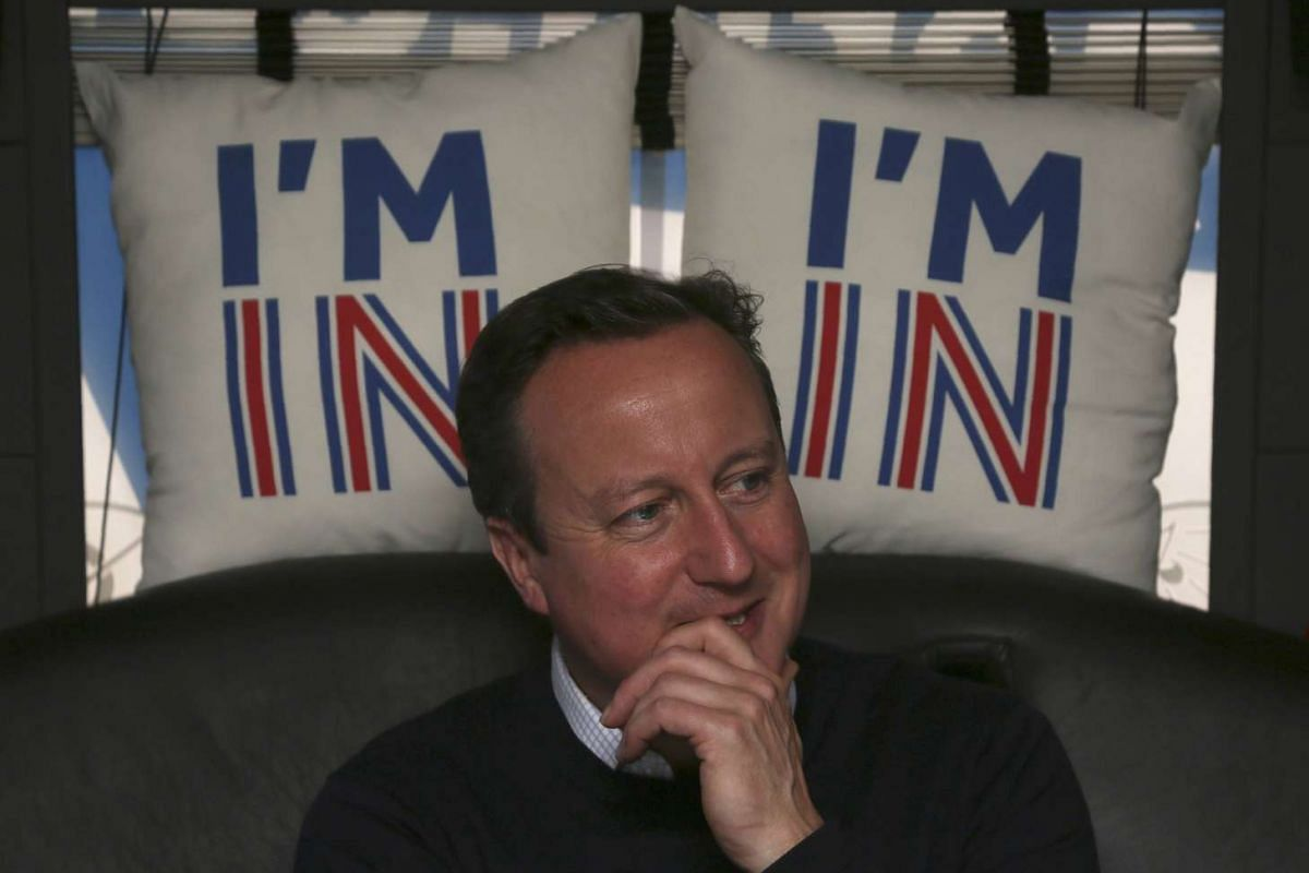 British Prime Minister David Cameron reacts as he travels on his campaign bus from Bristol, on June 22, 2016.