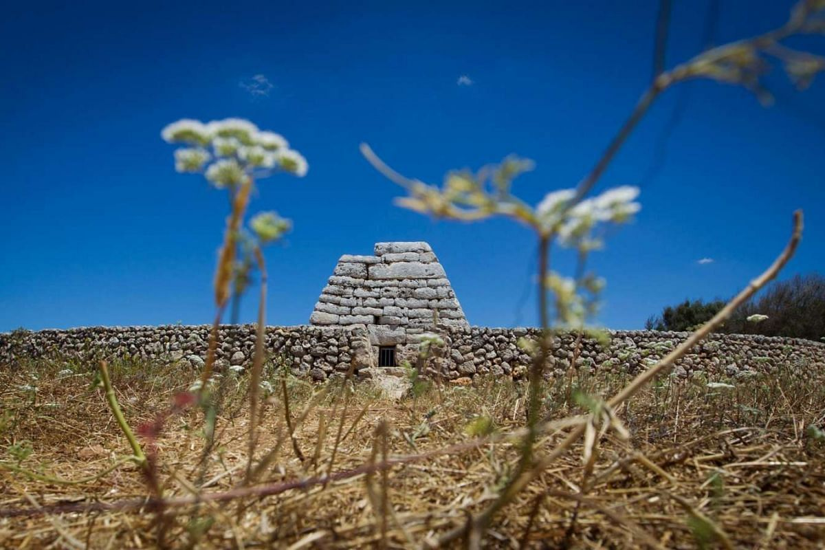 A picture taken on June 22, 2016 shows the Naveta des Tudons, a prehistoric monument near the Ciutadella on the island of Menorca.