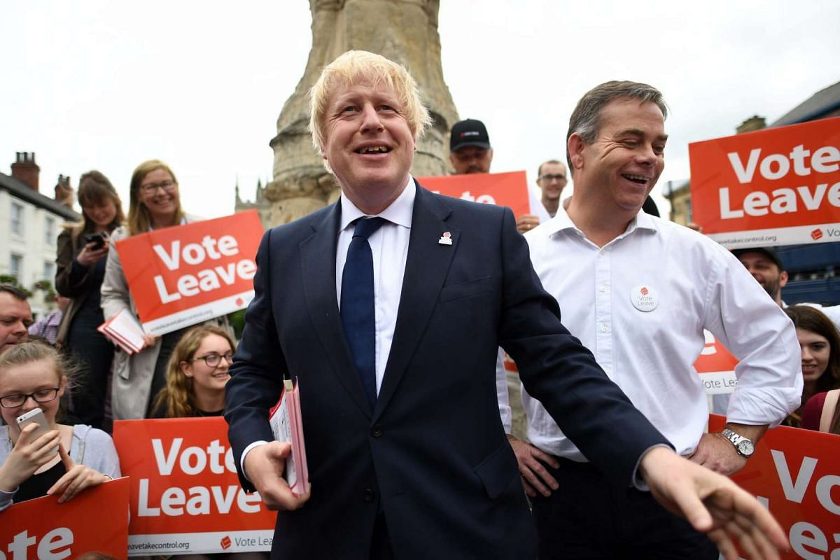 British Member of Parliament and former London Mayor Boris Johnson (left) in Selby during a campaign visit in Central London, on June 22, 2016.