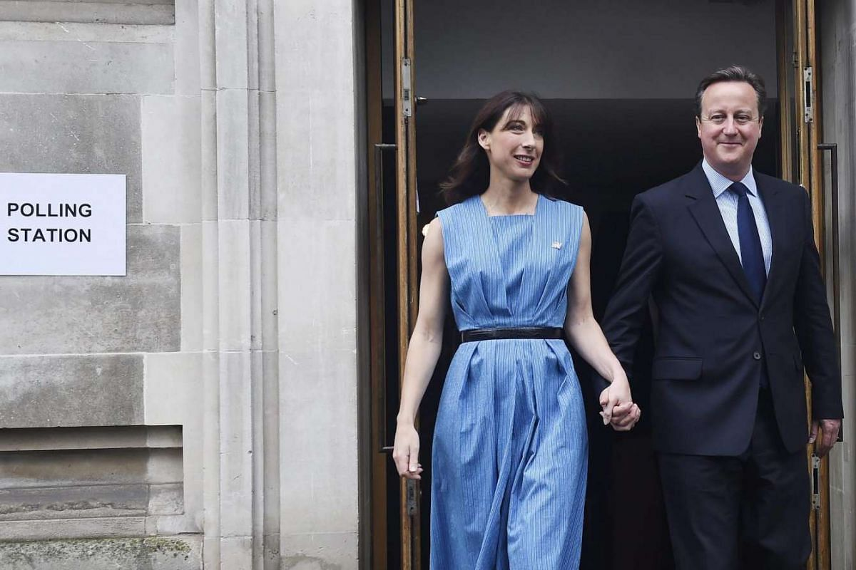 British Prime Minister David Cameron and his wife Samantha leave after voting at the Central Methodist Hall in London on June 23, 2016.